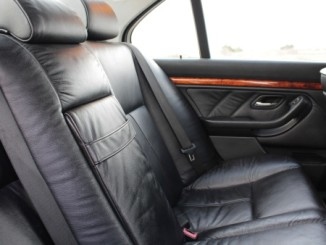 Rear black leather vehicle seats